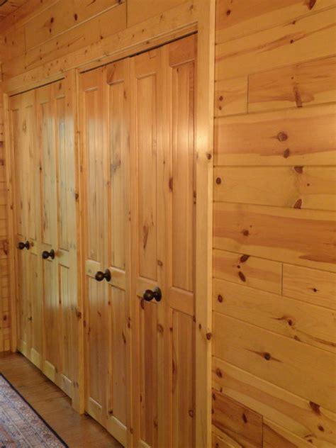 bi fold closet doors made with knotty pine paneling