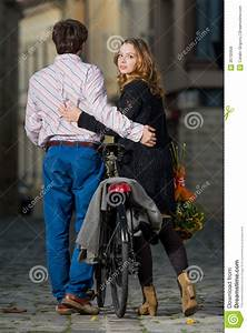 Young Man And Woman Walking Away Together Royalty Free ...