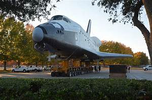 Space shuttle parking shuffle: Mock orbiter moved in ...