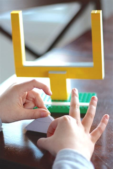 paper football game  lego goal posts screen