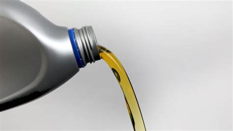 Motor Oil Pouring From Plastic Stock Footage Video (100