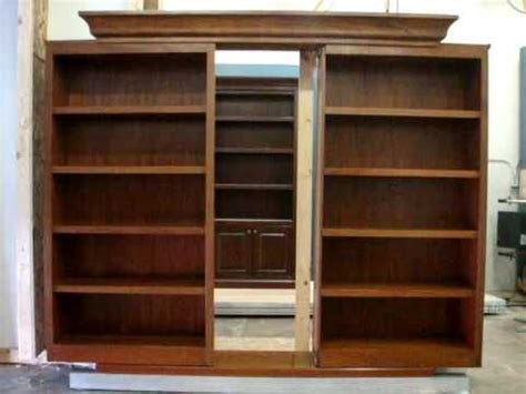 sliding bookcase doors reveal hidden passage secret