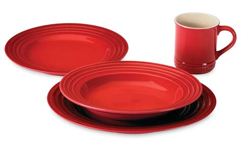le creuset stoneware dinnerware set  piece cherry red cutlery