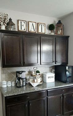 How To Decorate Cupboard by Best 25 Above Cupboard Decor Ideas On Cabinet