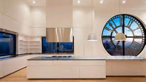 kitchen of modern penthouse with big clock windows home building furniture and interior