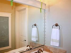 How to frame a mirror hgtv for Molding around mirror bathroom
