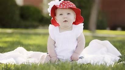 Blur Grass Sitting Wearing Cap