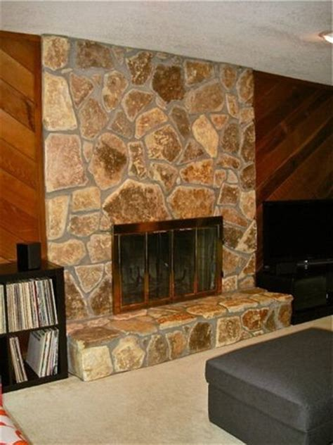 cedar plank wall and light stone fireplace 70 s house floor color