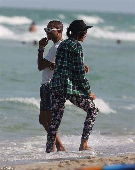 pharrell williams relaxes   miami beach  wife helen