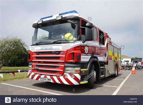 A British Fire Service Fire Engine Parked Up At A Village
