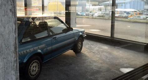 Abandoned Car Dealership With Mazdas, Hondas And Saabs