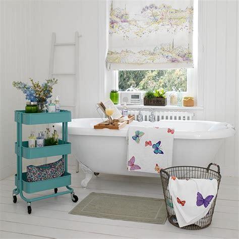 vintage white bathroom  roll top bath  blue storage