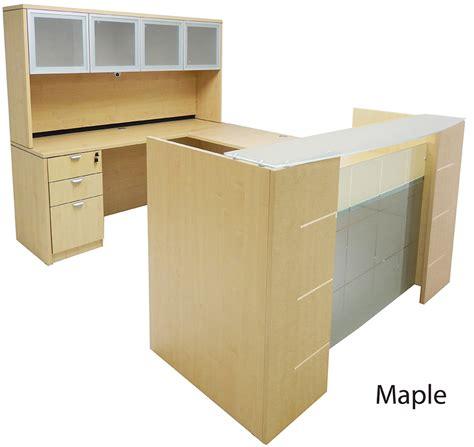 shaped glass front reception desk whutch