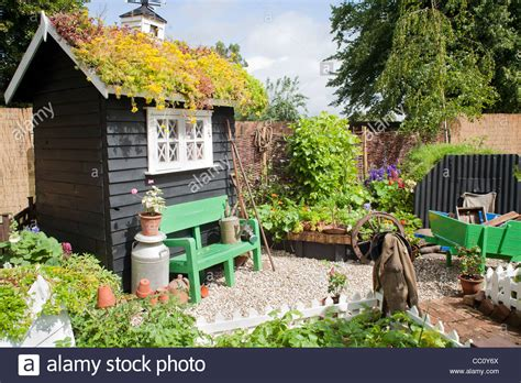 Small Kitchen Garden With Black Painted Shed And Edible. Knotty Wood Kitchen Cabinets. Kitchen Paint Tesco. Kitchen Art Ecoramic. Kitchen Cart Johannesburg. Kitchen Makeover Guide. Open Kitchen Living Room Layout. Tiny Kitchen Videos Youtube. Kitchen Window Canopy
