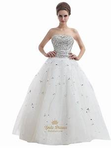 ivory strapless heavily beaded bodice tulle ball gown With ivory ball gown wedding dress