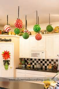 christmas ceiling fan decorating ideas decor oversized ornaments with coordinating ribbon suspending from the