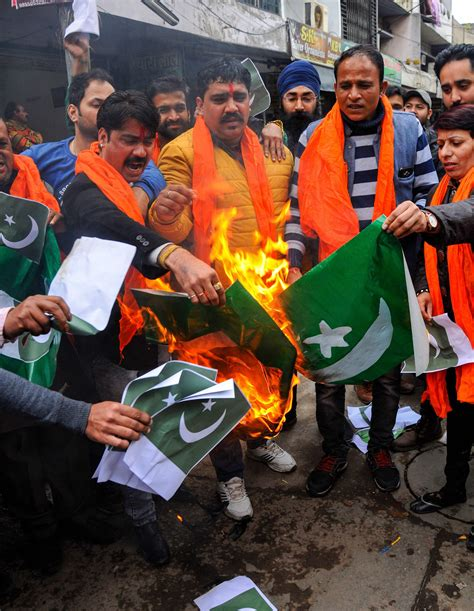 Pulwama attack: As tempers flare, Pak flag burnt in ...