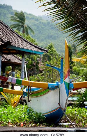 Balinese Fishing Boat by Balinese Fishing Boat Called A Jukung On Sanur Beach Bali
