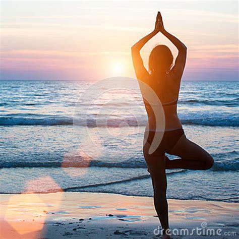Yoga Silhouette Woman Doing Meditation Near The Ocean