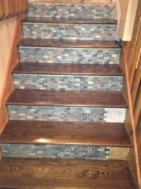 Stone backsplash tile used on stair risers!!   Home