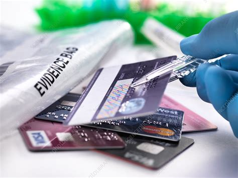 Credit card fraud can be authorised, where the genuine customer themselves processes a payment to another account which is controlled by a criminal, or unauthorised, where the account holder does not. Credit Card Fraud - Stock Image - F023/7176 - Science Photo Library