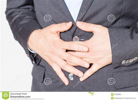 Close Up Of Businessman With Strong Stomach Pain Stock