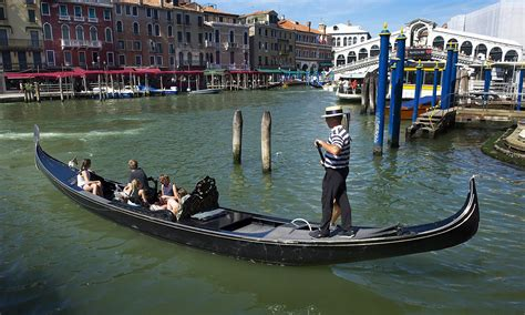 Gondola Boat Operator by Venice In Reflective Mood Over Gondola Safety Changes