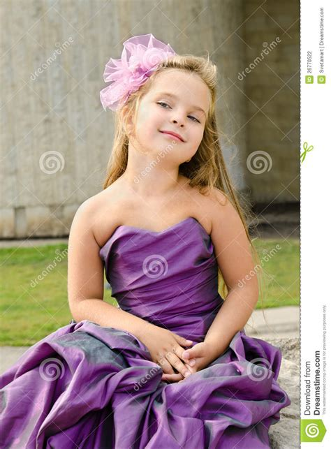 Portrait Of Cute Little Girl In Princess Dress Stock Photo