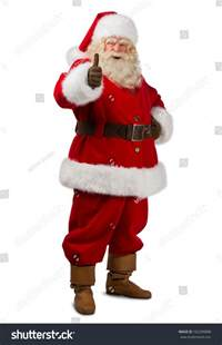 santa claus standing isolated on white background and thumbs up full length portrait stock