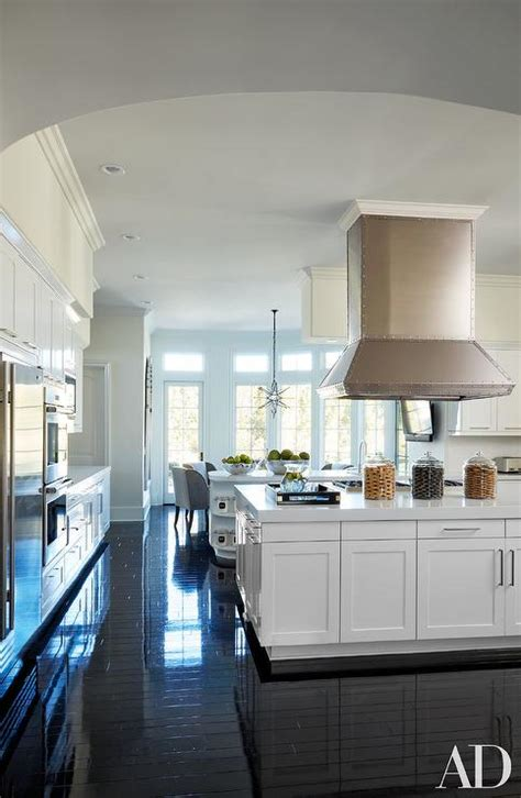 white kitchen  glossy black floors transitional
