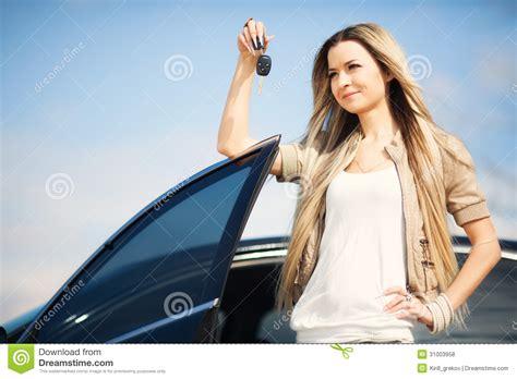 Girl With Car Key Royalty Free Stock Photos
