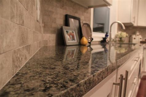 caledonia granite tumbled subway tile backsplash white