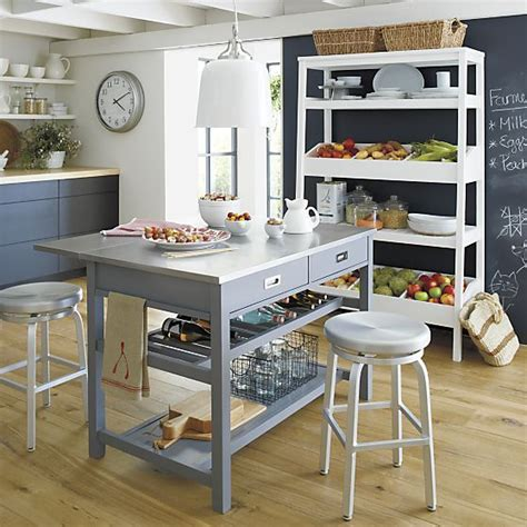kitchen island with open shelves grey kitchen island shelves white pendants and