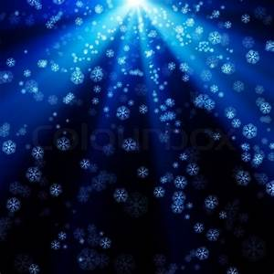 Snowflakes falling on the background of blue luminous rays ...