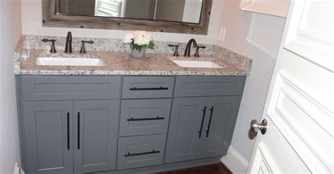 grey shaker cabinets  oil rubbed bronze pulls  faucets dallas white granite pella