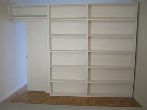 Bookcase Divider Wall by Free Standing Bookcase Divider With Hide Away Pocket Door