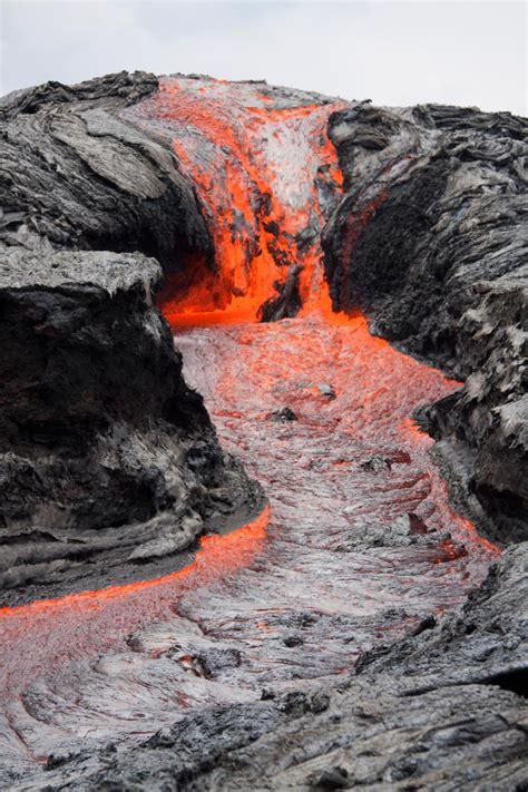 video scientists film fast  hawaii lava flow  ground