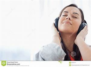 A Peaceful Woman Listening To Music On Her Headphones ...