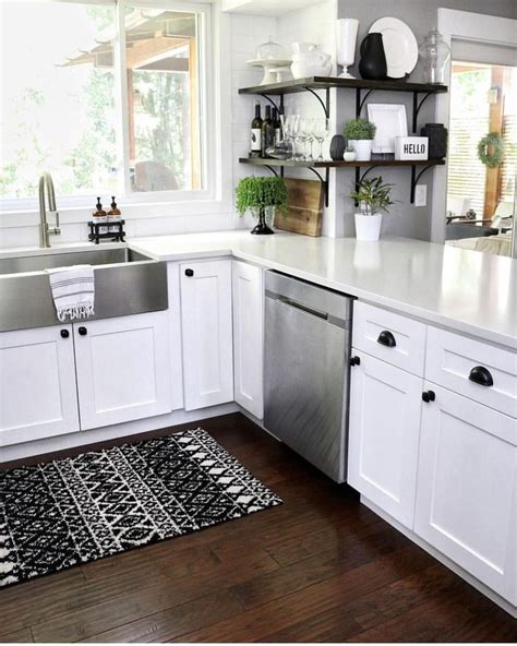 Black cabinets are a hard yes for us. Black & White Neutral Kitchen with shaker cabinets, black hardware, stainless steel farmhouse ...