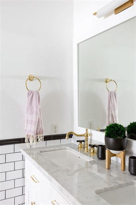 bathroom white subway tiles  gray grout transitional