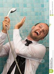 crazy business man fighting with shower in bathroom stock With men in the bathroom