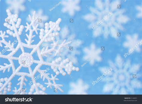 Glitter Snowflake Background by Snowflake Design Macro Image Snowflake Ornament Stock