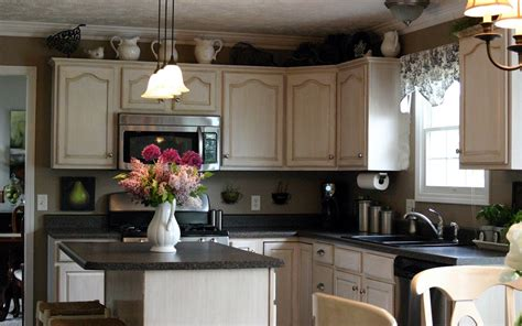 Decorating Ideas For On Top Of Kitchen Cabinets by Ideas For Decorating The Top Of Kitchen Cabinets
