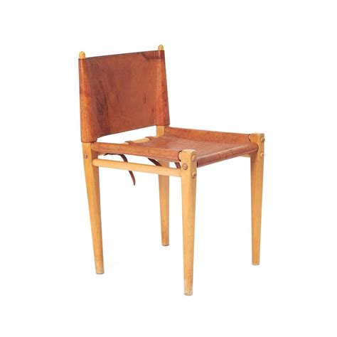 mid century italian leather and wood dining chairs by