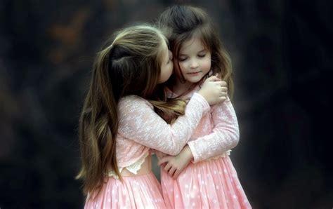sisters kiss wallpapers