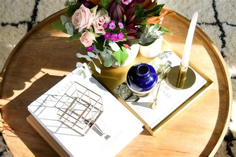 If you plan on displaying a decent number of items or smaller items on your coffee table, using a tray is your key to success. How to style your coffee table: Coffee table styling tips and tricks - STYLE CURATOR