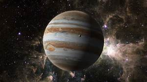 An Orbiting Shot Of Planet Jupiter In Space, With One Of ...