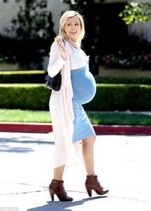 Holly Madison displays her baby bump in tight blue dress ...