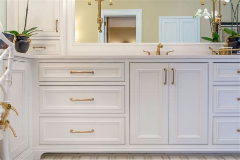 white bathroom cabinets champagne bronze finish hardware