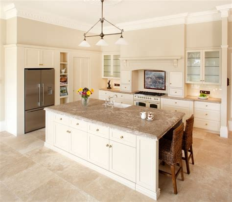 white kitchen cabinets beige countertop travertine countertops a touch of style in the modern 1787